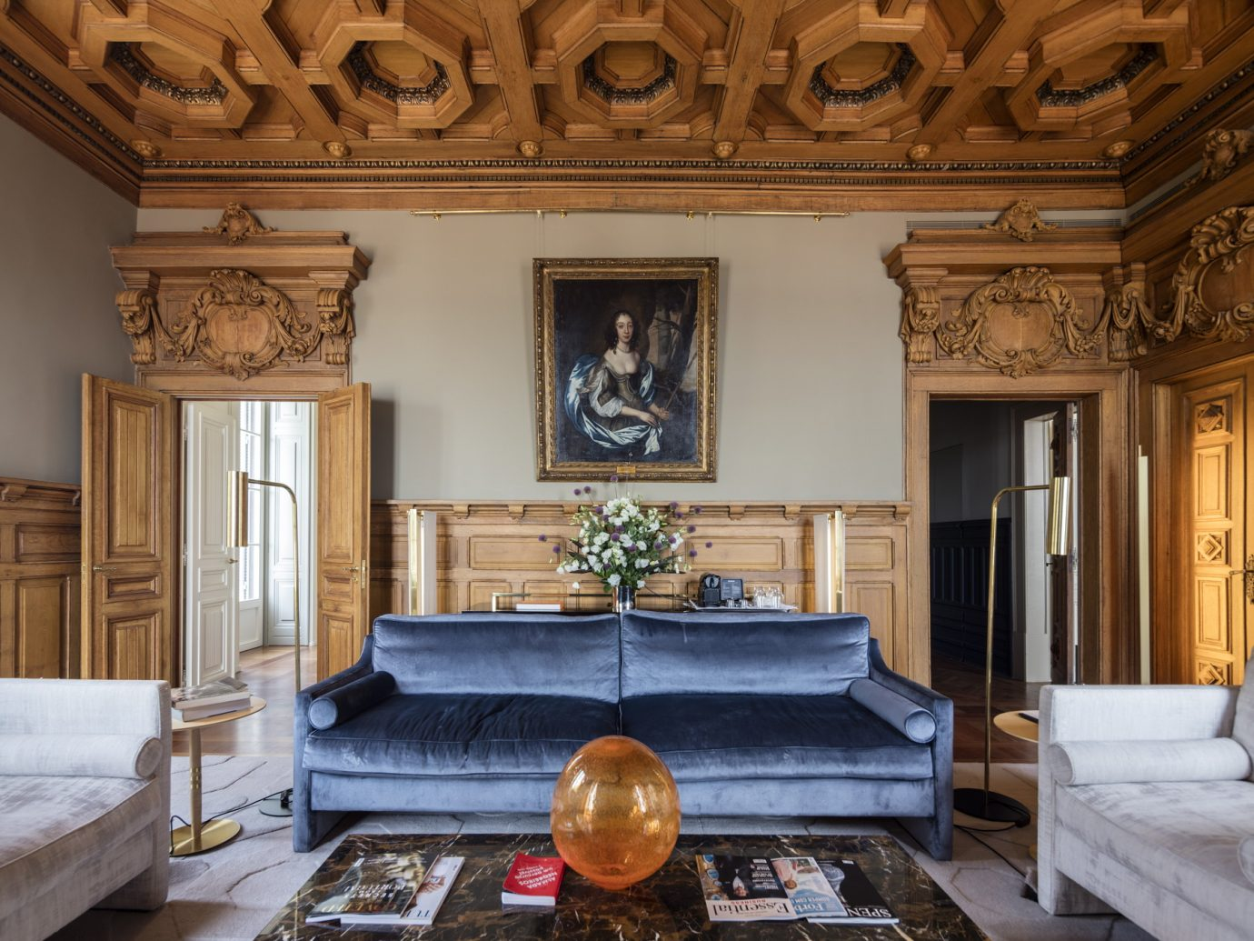 Luxurious interior space with blue velvet couch at Verride Palácio Santa Catarina