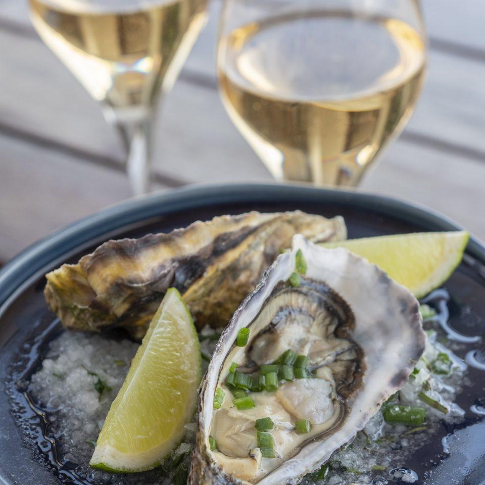 Fresh shellfish and white wine at Verride Palácio Santa Catarina