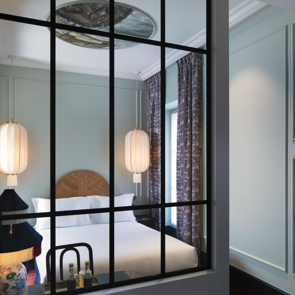 Visual of bed through glass window decor, Hôtel Monte Cristo