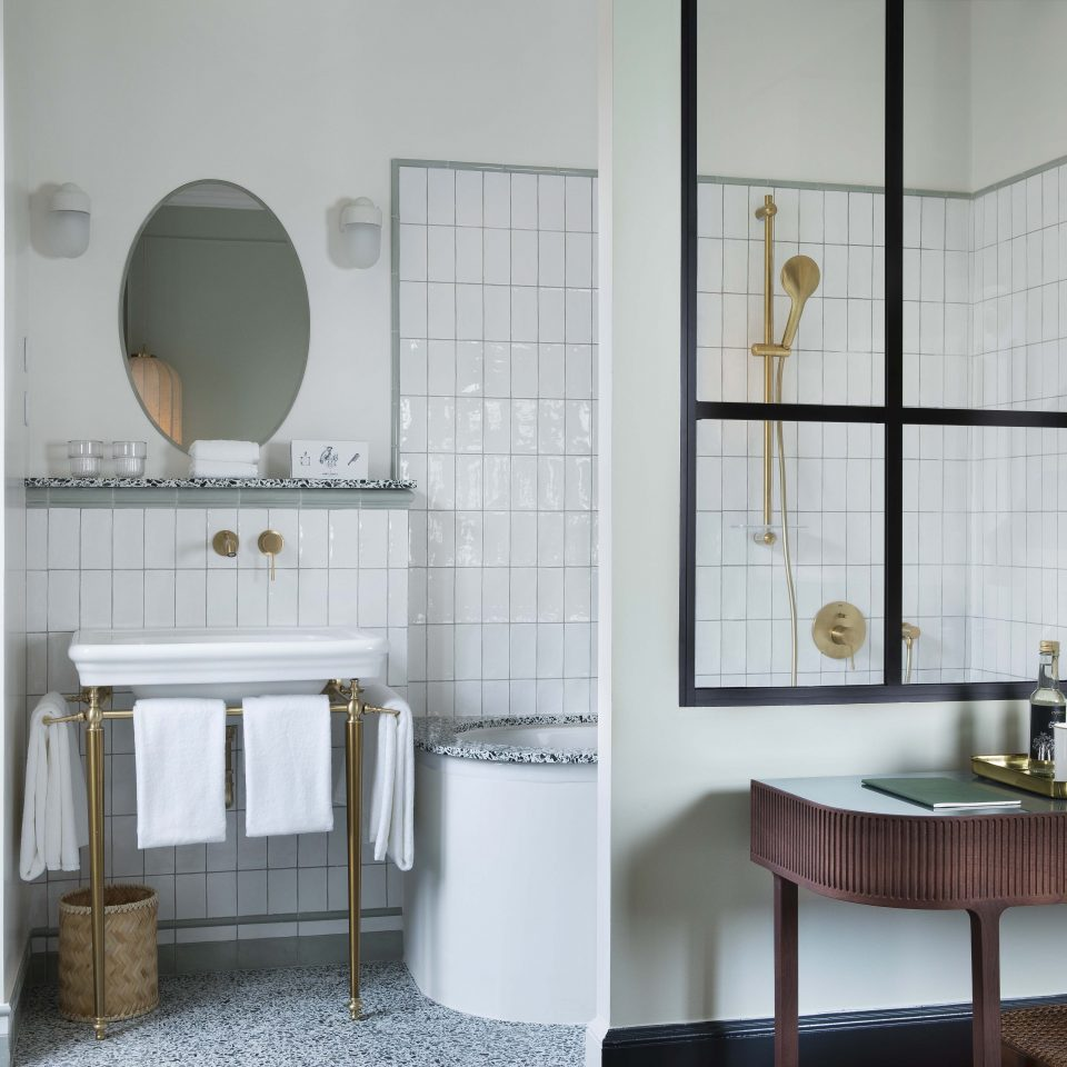 Pastel tiled bathroom with golden shower head, Hôtel Monte Cristo