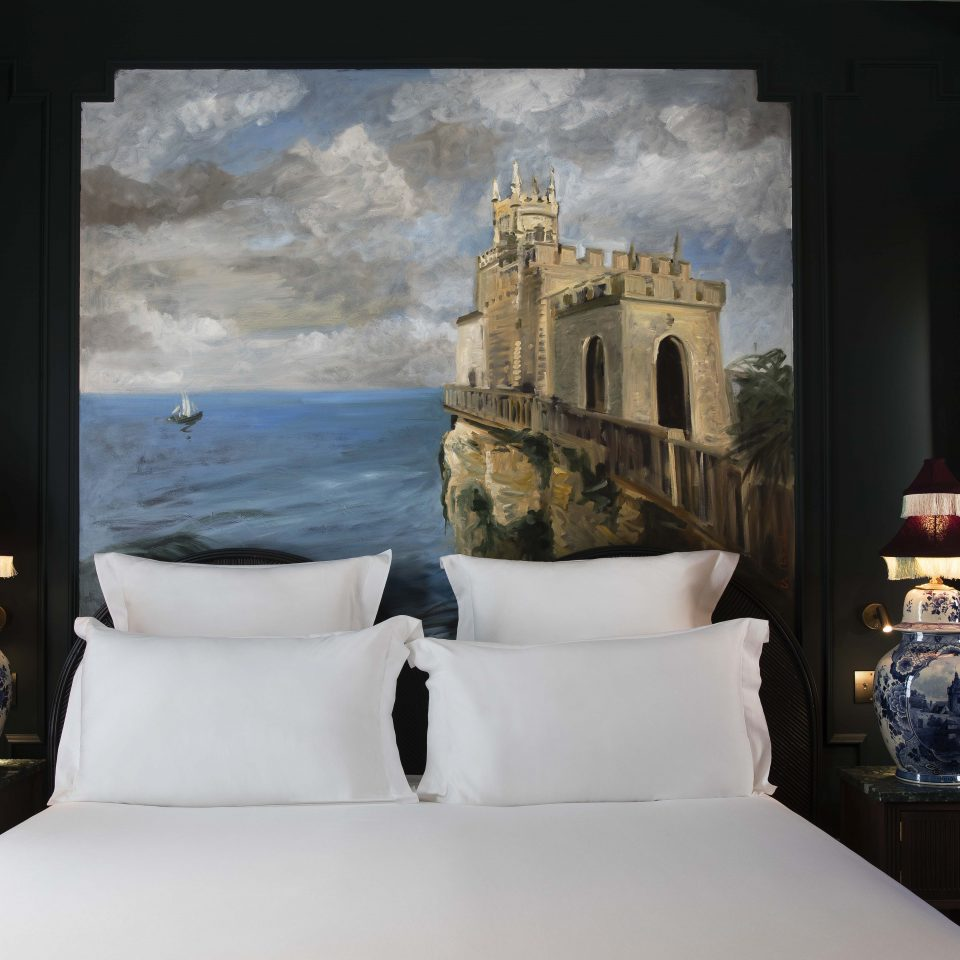 White bed with castle painting wall decor, Hôtel Monte Cristo
