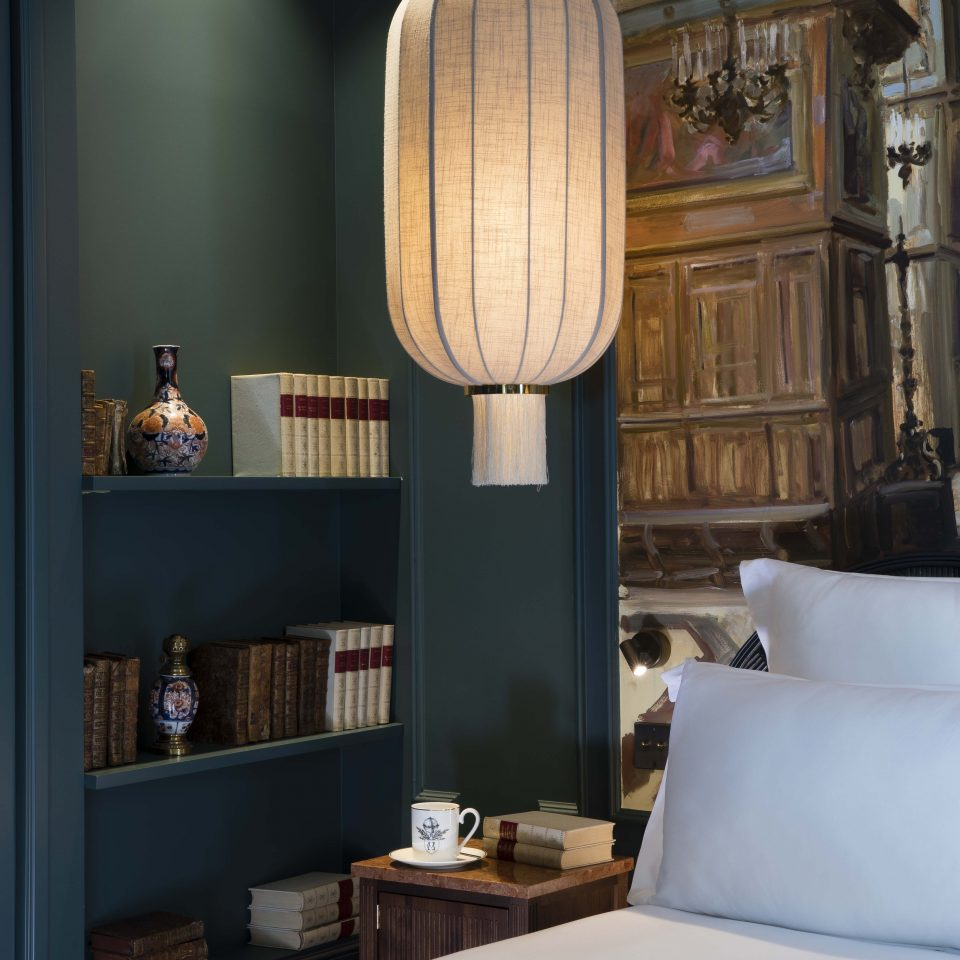 Bed with green walls and paper lantern decor, Hôtel Monte Cristo