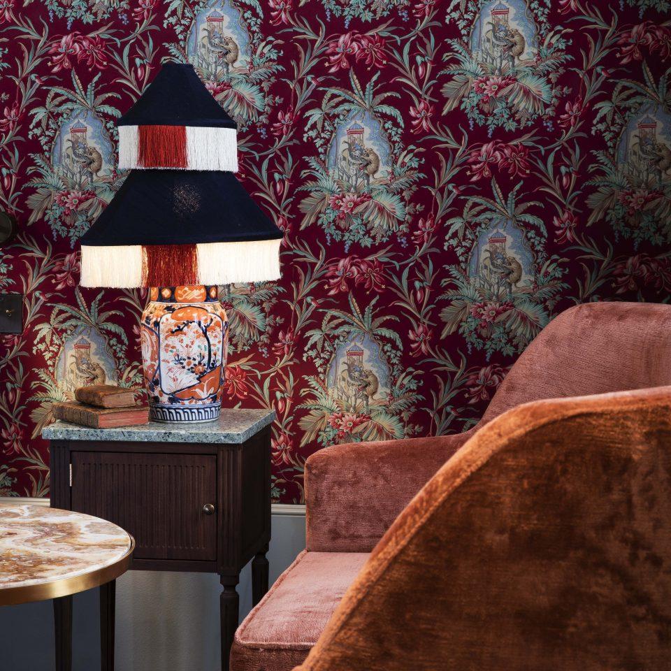 Eccentric wall decor, funky lamp, and velvet corner chair, Hôtel Monte Cristo