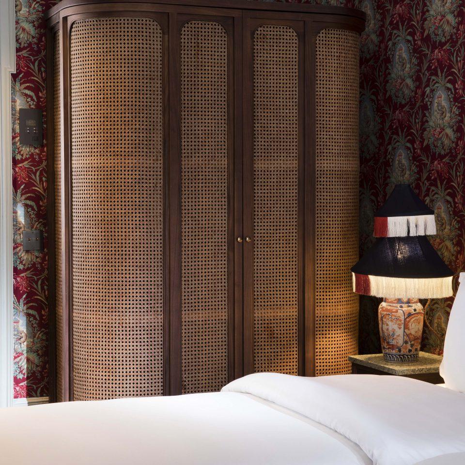 Ceiling to floor brown basket wardrobe in hotel room, Hôtel Monte Cristo