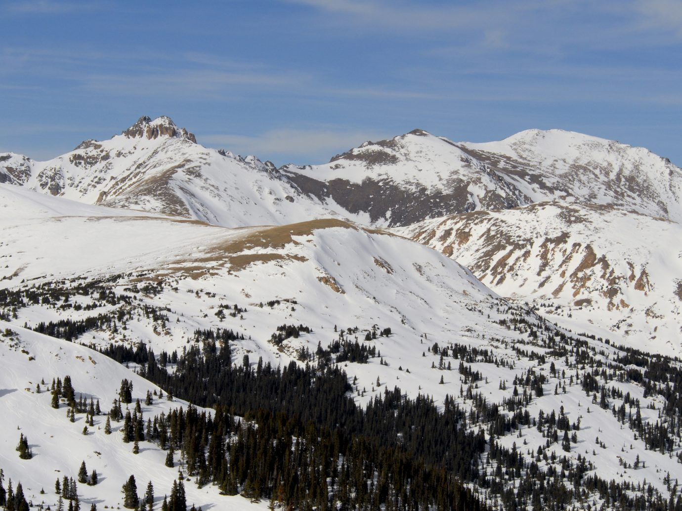 Rocky Mountain peaks in Colorado, covered in early season snow.