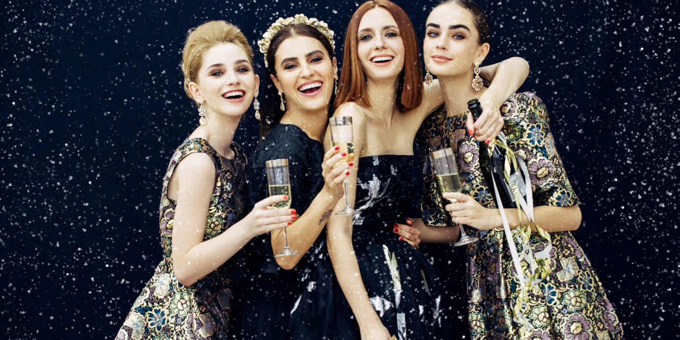 Stylish women at a holiday party with champagne