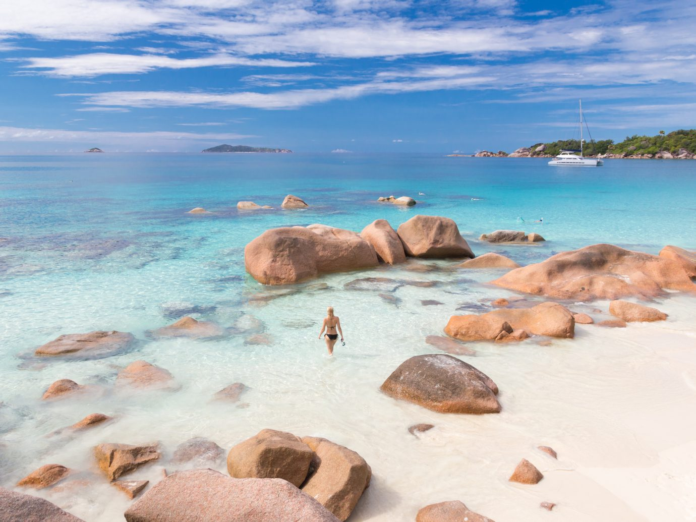 4 Anse Lazio, Prasilin Island, Seychelles, Woman wearing stylish bikini enjoying swimming and snorkeling at amazing Anse Lazio beach on Praslin Island, Seychelles. Summer vacations on picture perfect tropical beach concept.