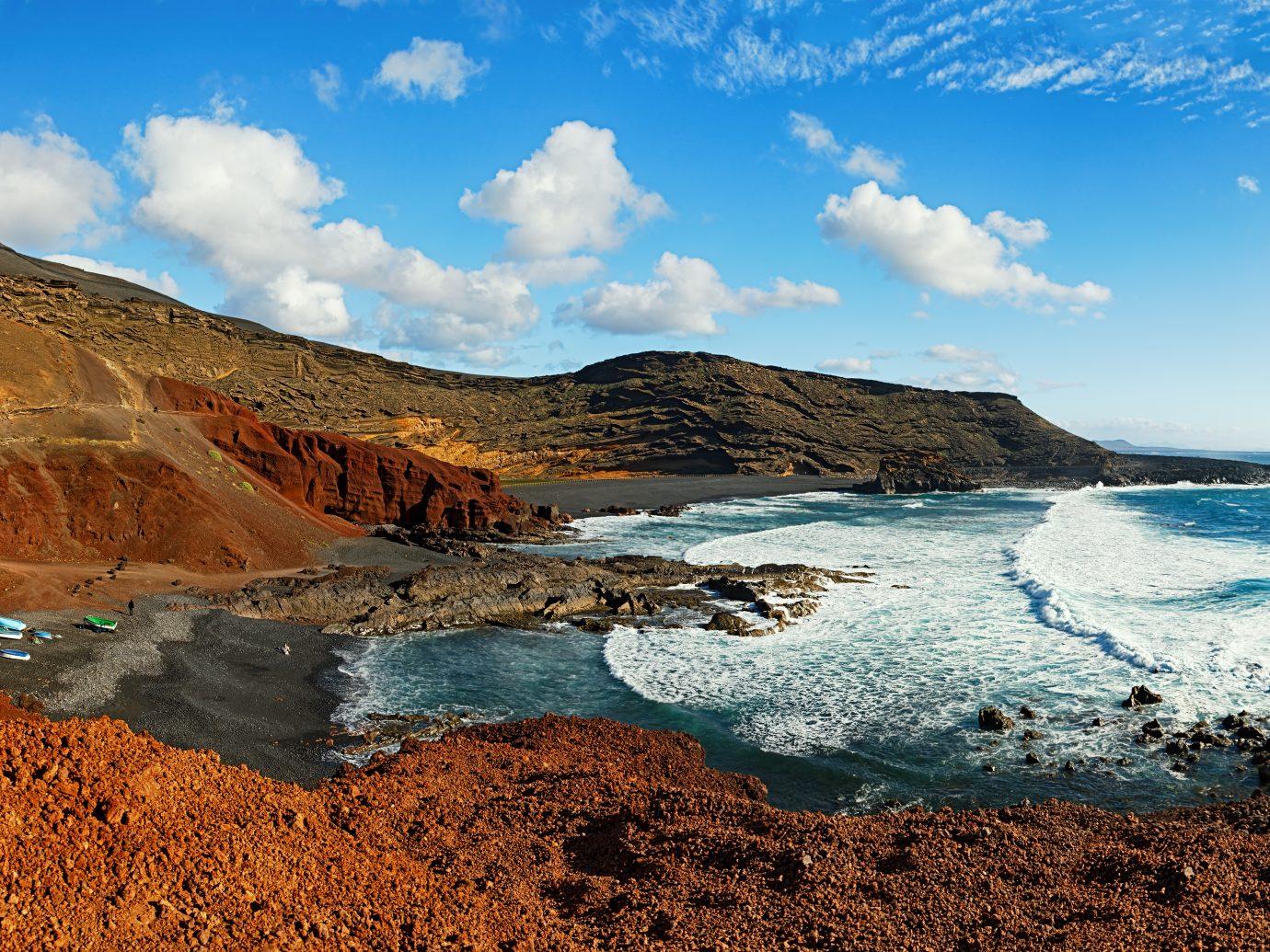 Panoramic view of El Golfo black sand beach near Green Lagoon in Lanzarote, Canary Islands.