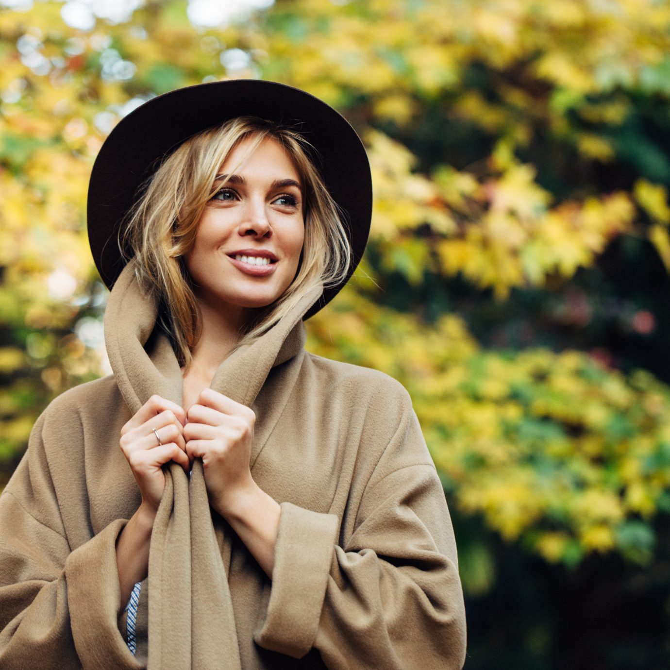 Autumn photo of a girl in a tan jacket, fall items to splurge on