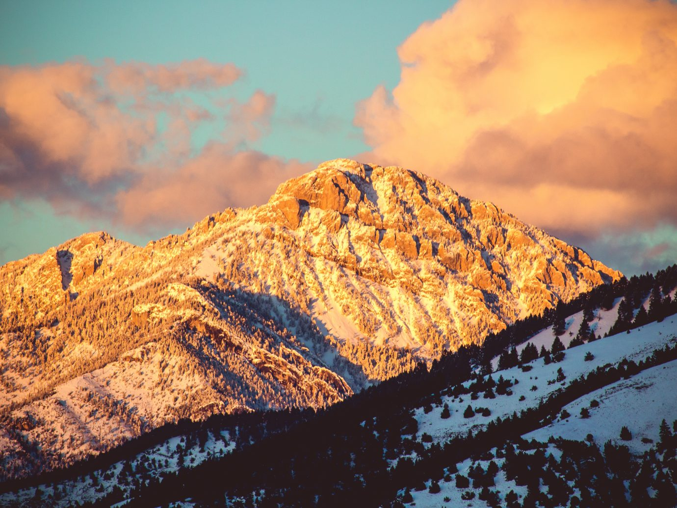 A sunset shines on the top of Ross Peak, in Bozeman, Montana.