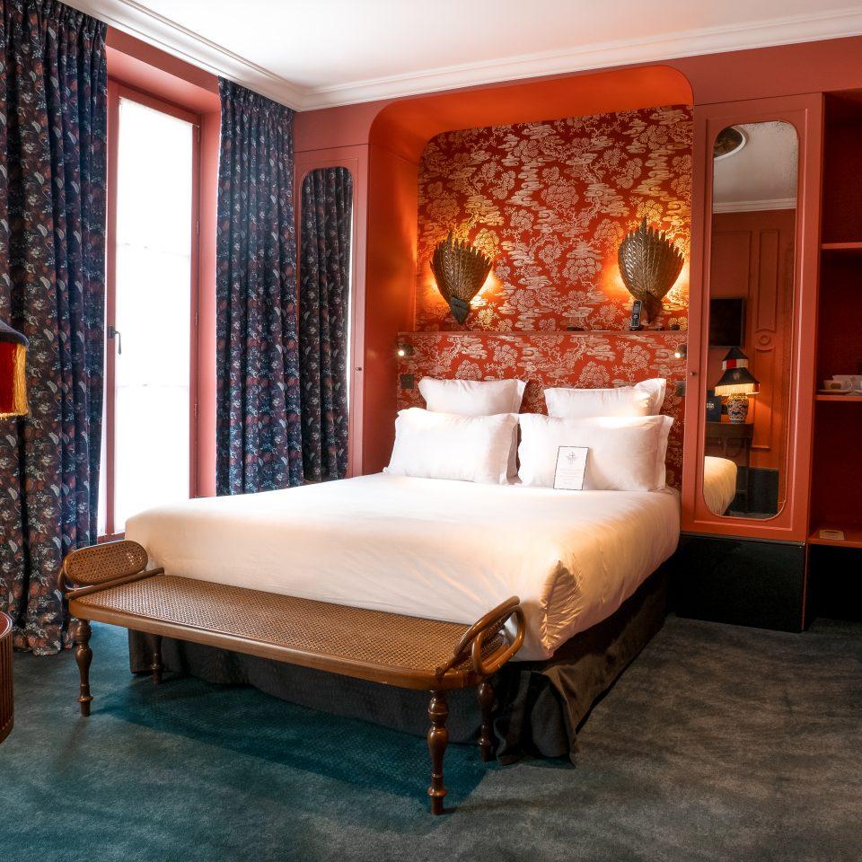 Corner of bed shot of red room at Hôtel Monte Cristo
