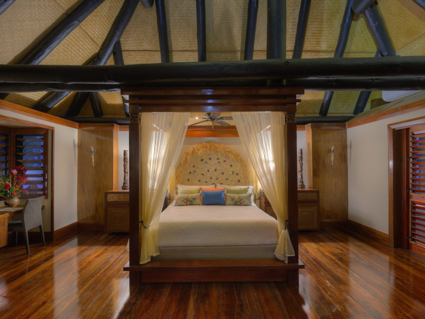 canopy bed in bedroom at Jean-Michel Cousteau Resort
