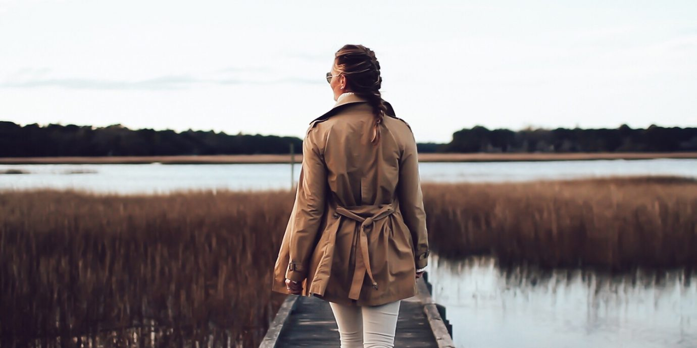 woman walking on a dock on a fall day wearing a trench coat, Best trench Coats