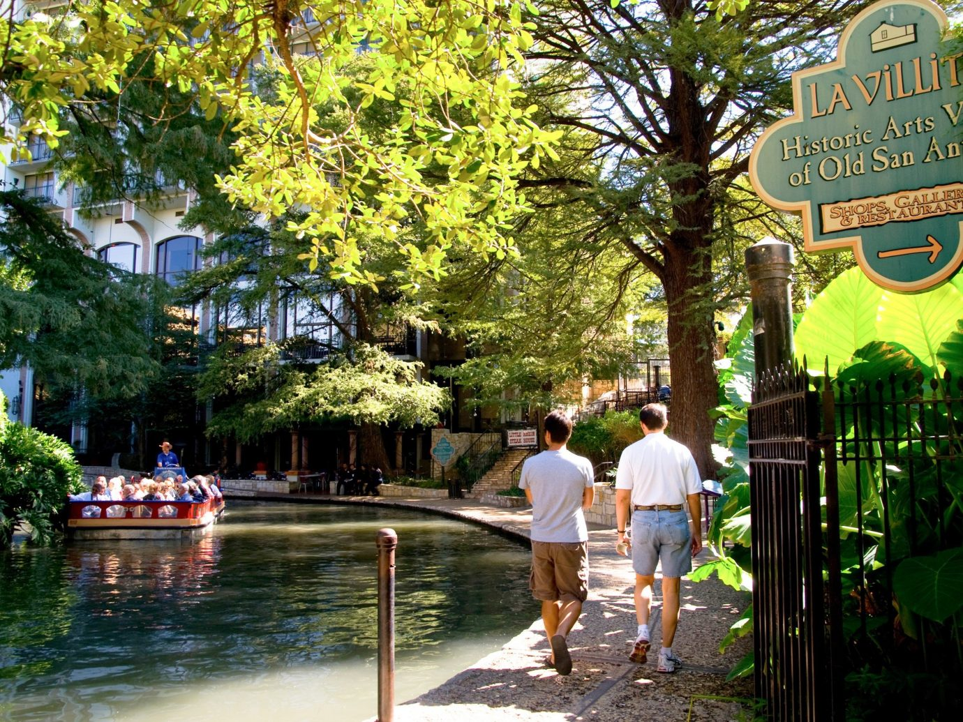 Two men walking in a park in the Historic District of San Antonio