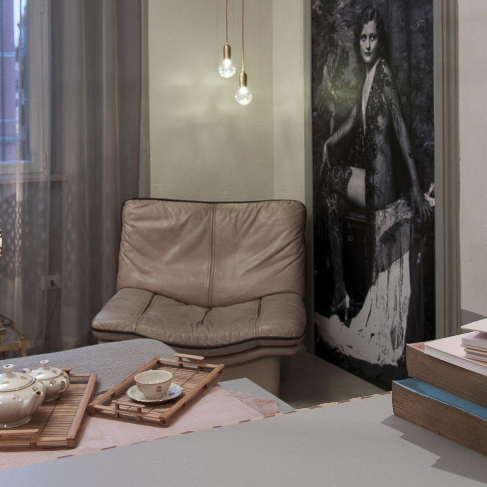 Tea set, chair, and books in room at Casacau