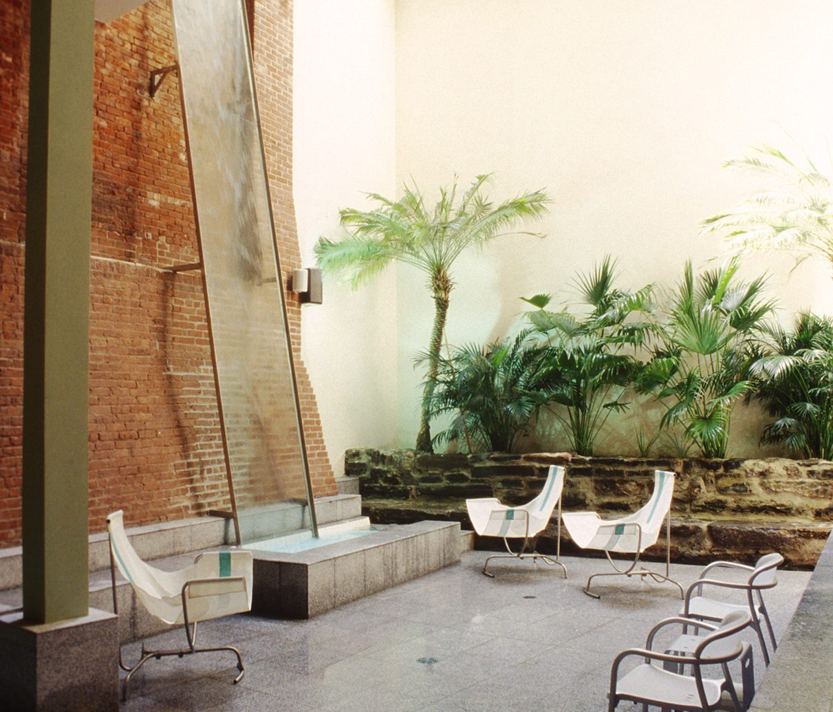 Image of indoor seating area next to spa pool with house plants and ceiling window at Great Jones spa
