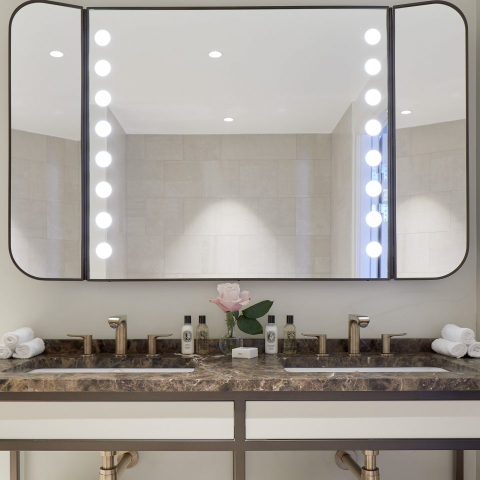 Mirror over counter in bathroom