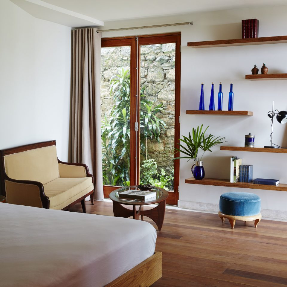 Bedroom with long opening windows and interesting wooden shelving