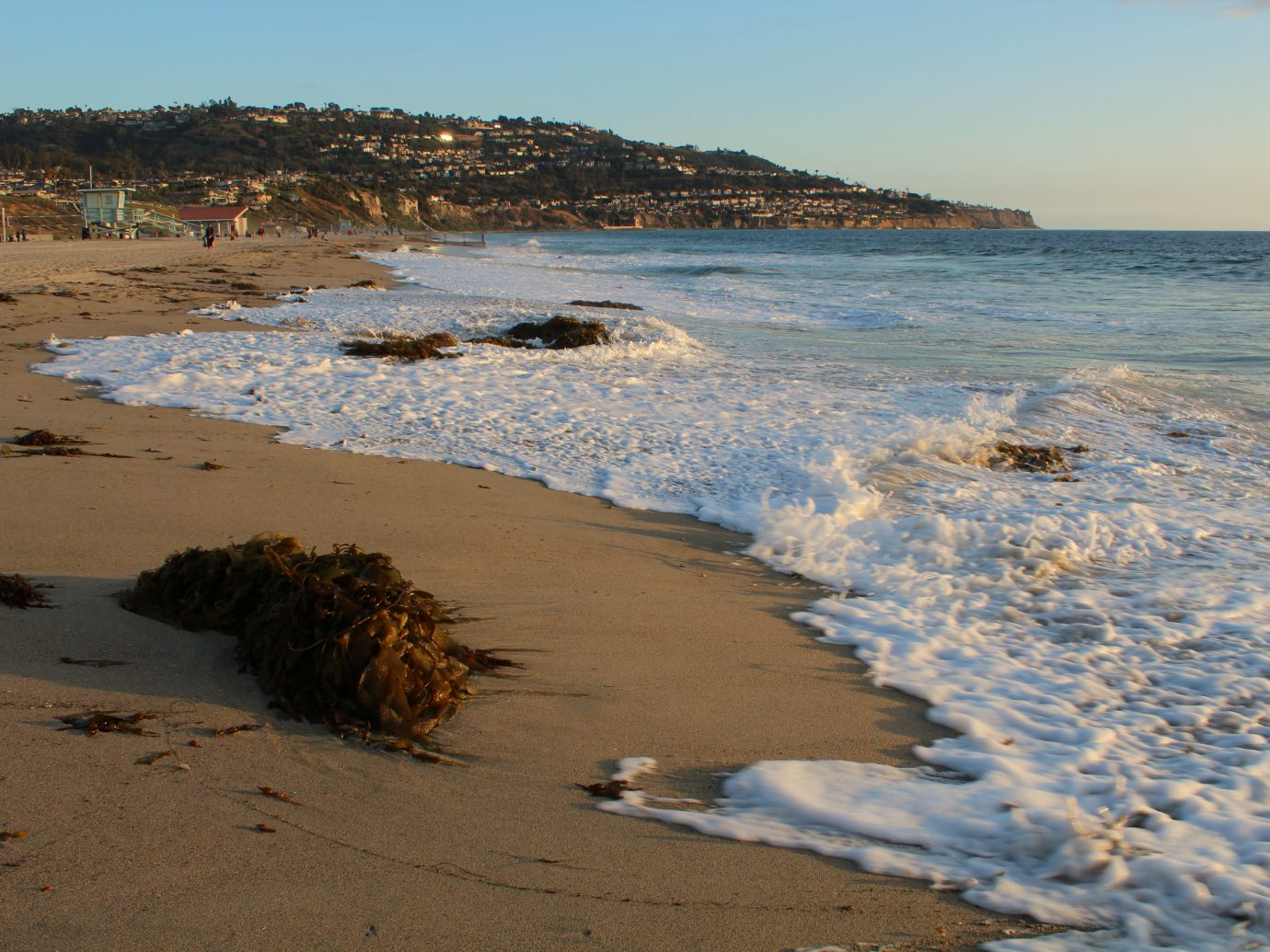 The scenic shoreline of Torrance Beach, with the Palos Verdes peninsula in the background.