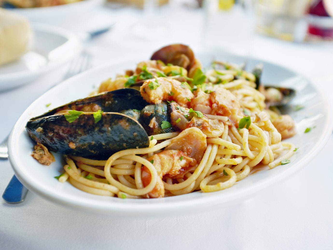 Fresh Seafood pasta - Spaghetti, clams, shrimps and squid, served in a restaurant in Italy.