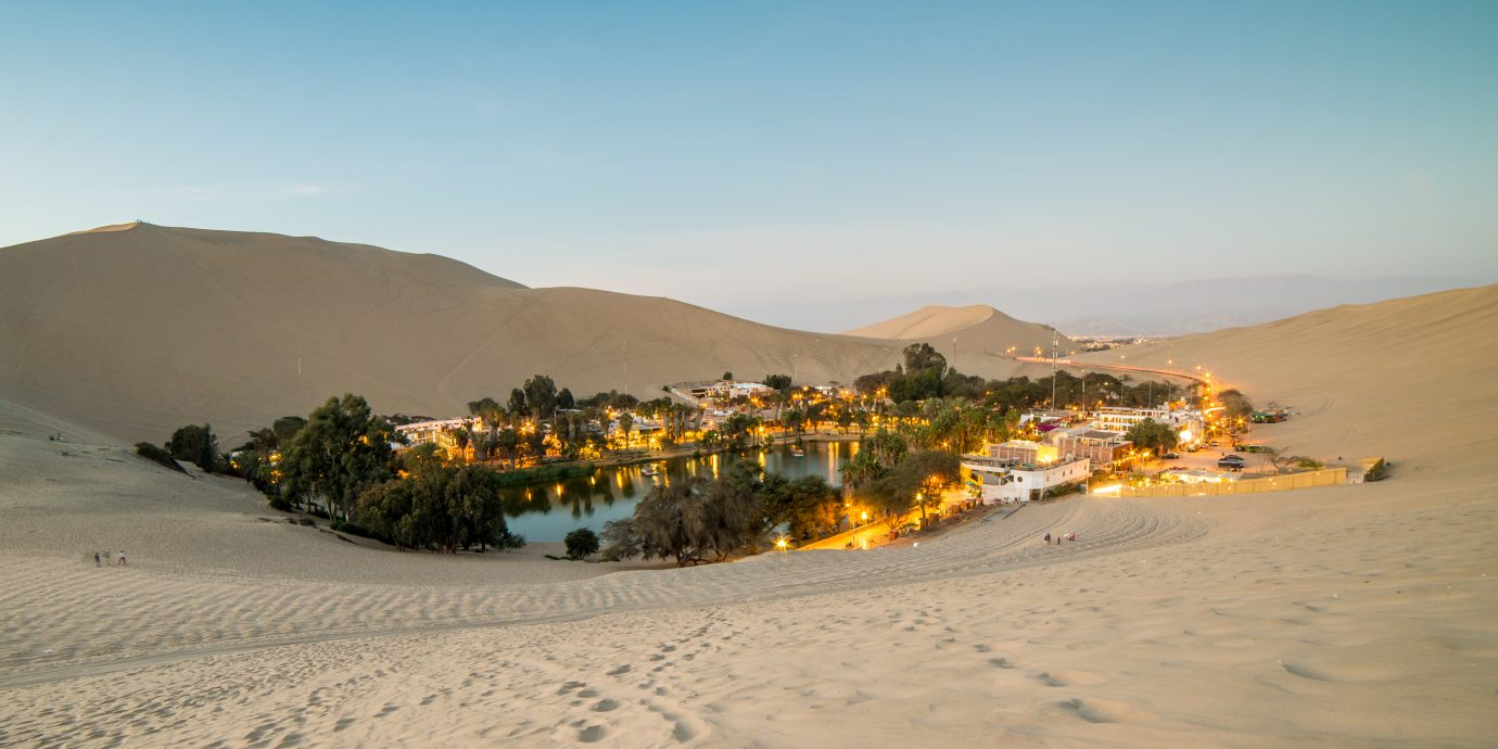Oasis within the sand dunes of Ica in Huacachina