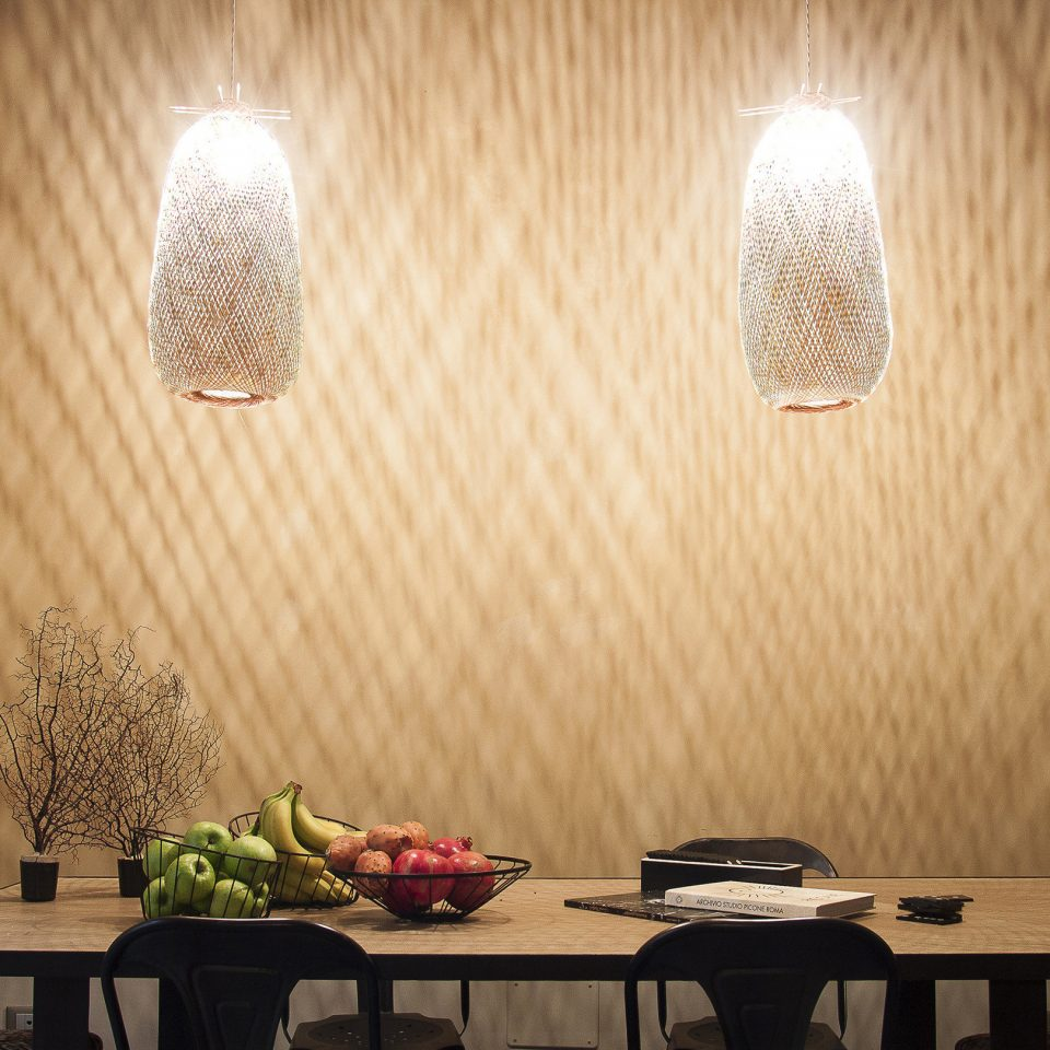 Table with fruit and two hanging lights at Casacau