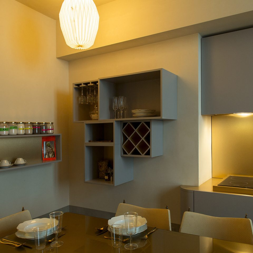 Larger photo of kitchen with box shelving and set table at Casacau