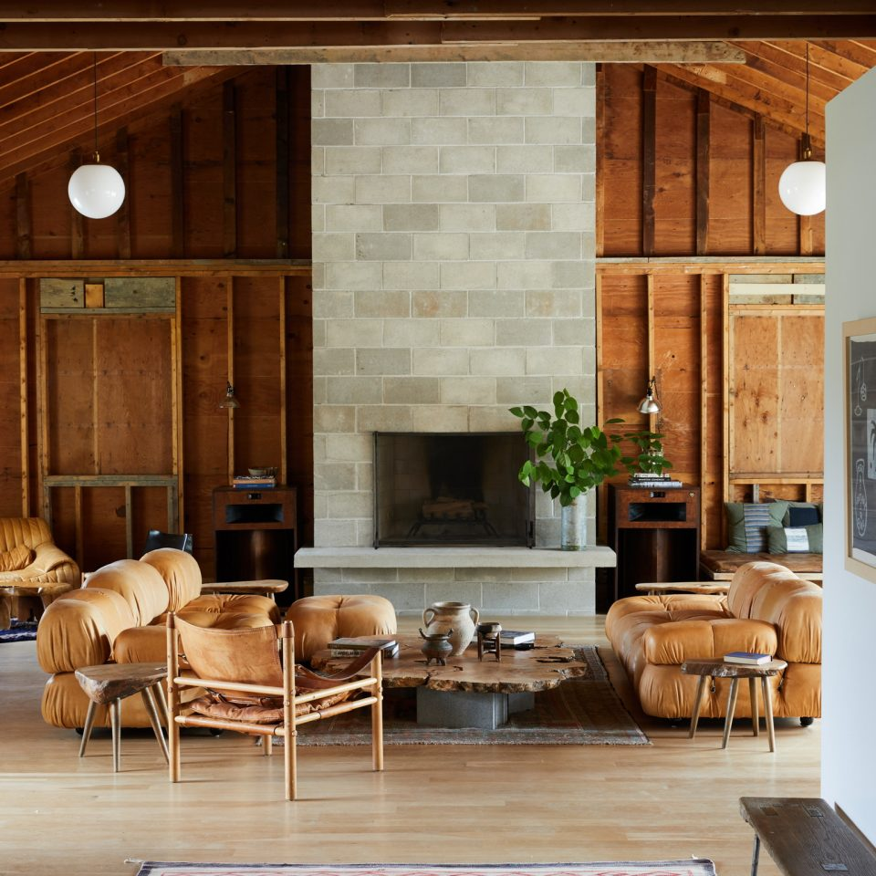 Living space interior with fireplace and comfy looking brown couches