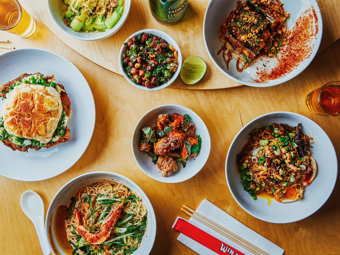 Overhead shot featuring numerous dishes at Win Son