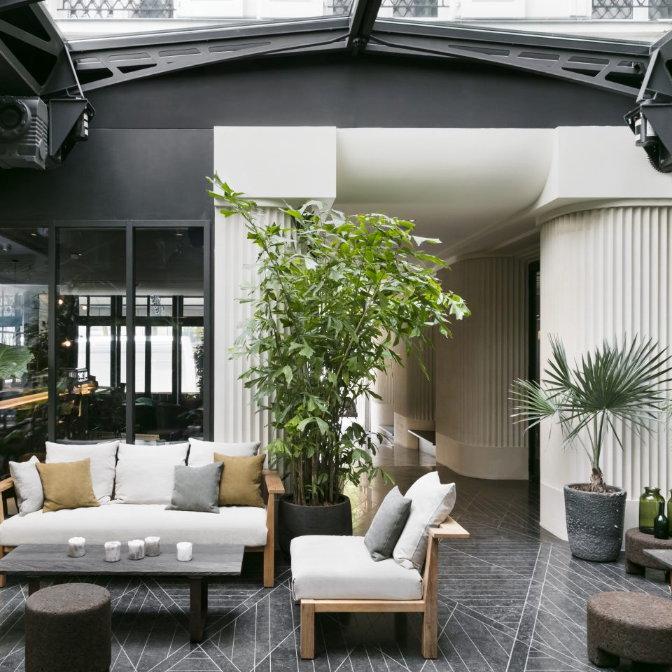 Lobby with houseplants and seating at Hotel National des Arts et Métiers
