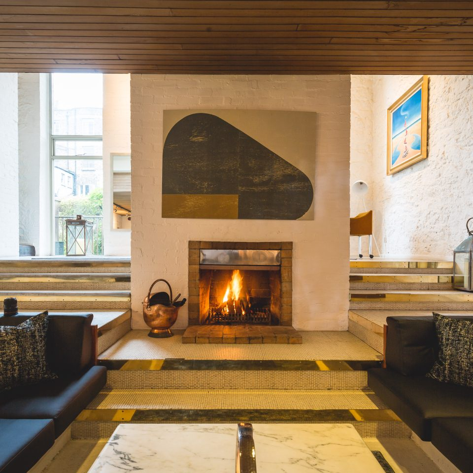Room with wrap around couch and fireplace at Number 31 in Dublin
