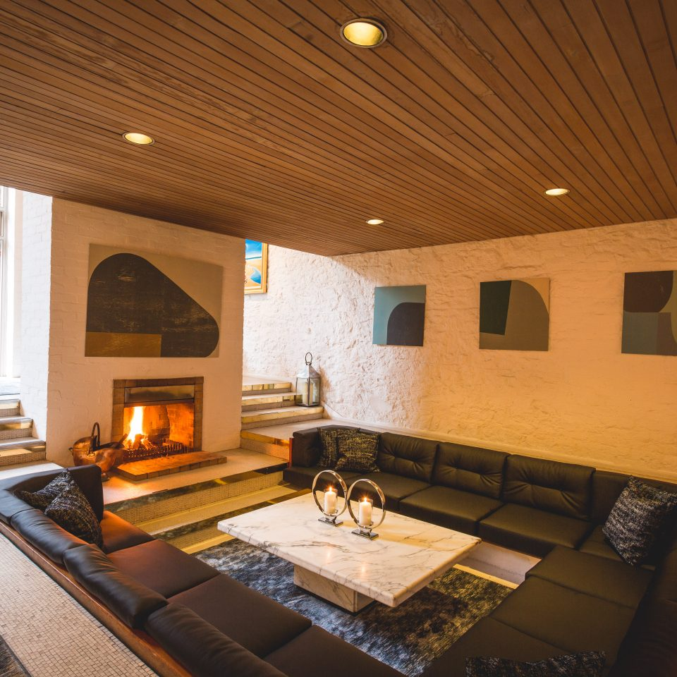 Room with square wrap around couch and a fireplace at Number 31 in Dublin