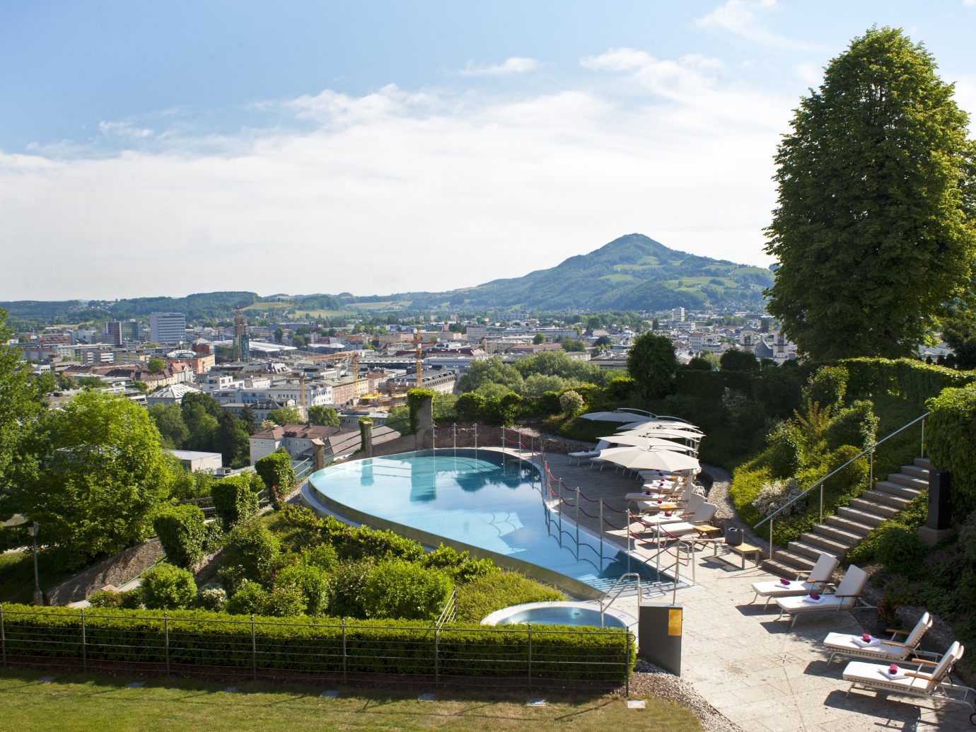 the grounds and pool at Schloss Mönchstein Hotel in Salzburg, Austria