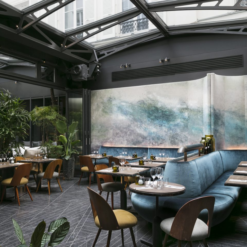 Entire set dining room with houseplants and a window roof at restaurant at Hotel National des Arts et Métiers