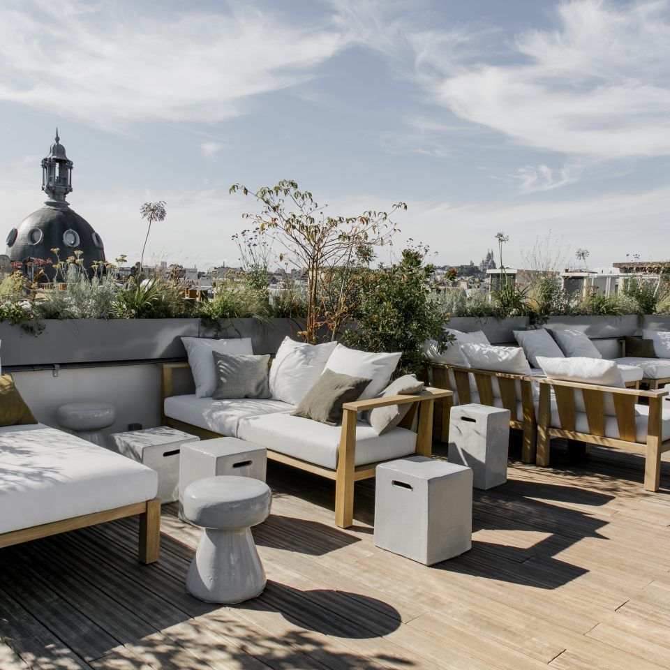 Rooftop with seating and plants on a pleasant day at Hotel National des Arts et Métiers