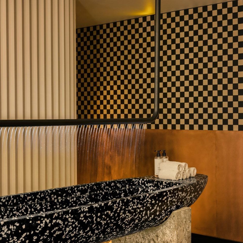 Large fancy black and white rock sink at the spa at Hotel National des Arts et Métiers