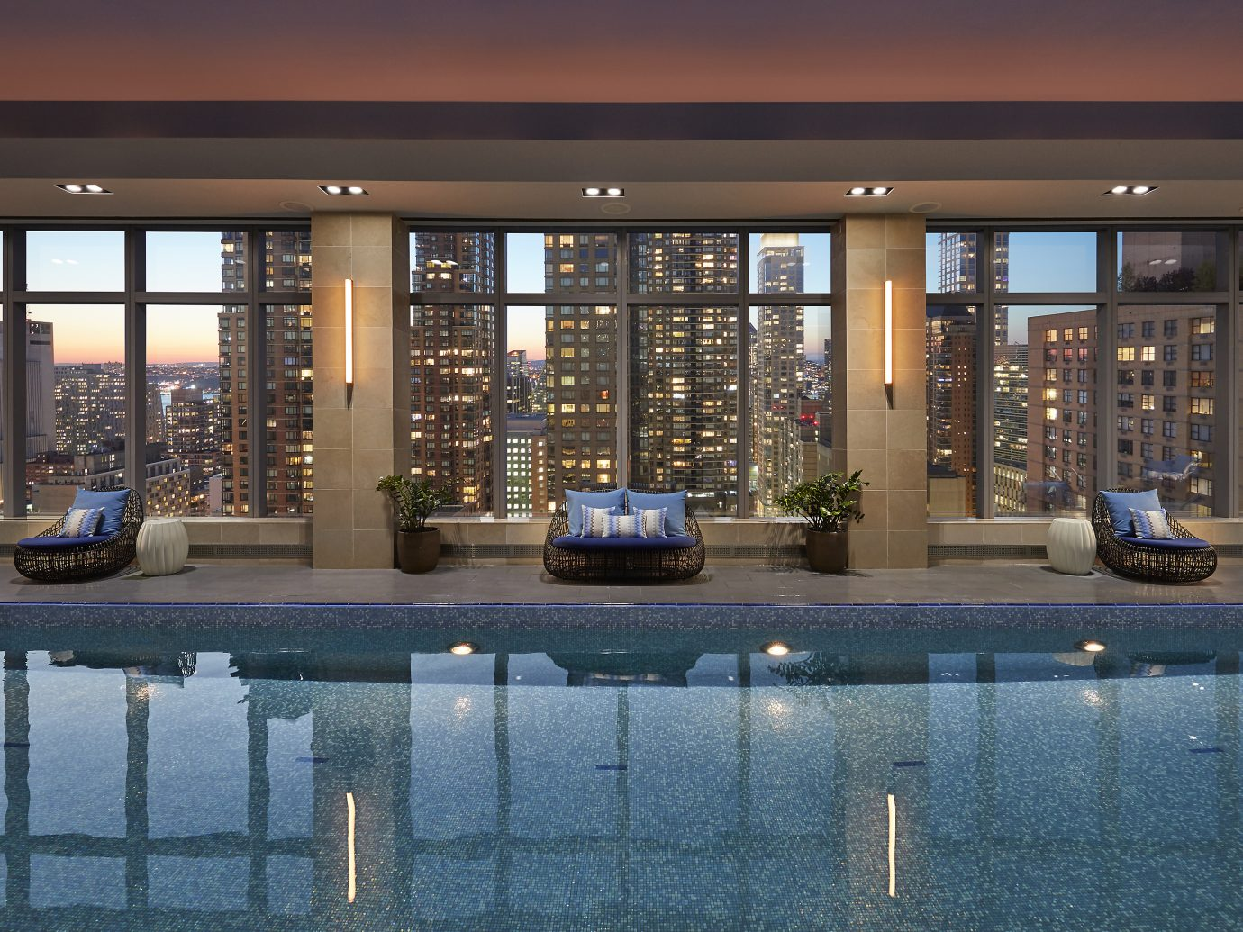 Wellness pool at dusk overlooking NYC at Mandarin Oriental