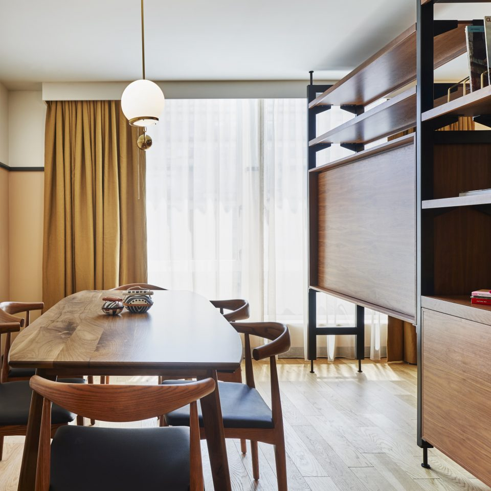 Dining table with storage furniture to the right