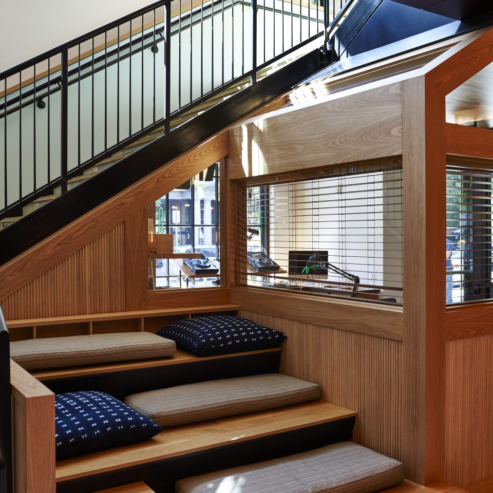 Comfy mock-stair seating area right below actual stairs
