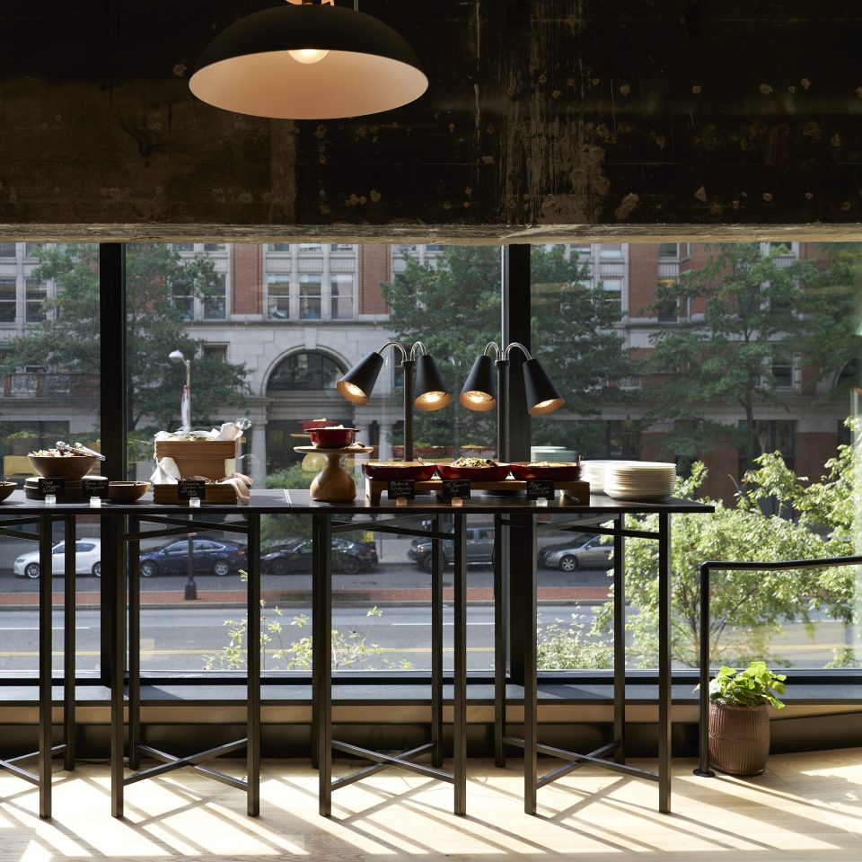 Tall bar-like table against a window with snacks displayed