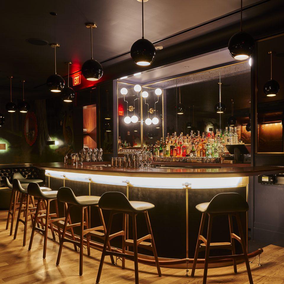 Under-lit bar in dark room