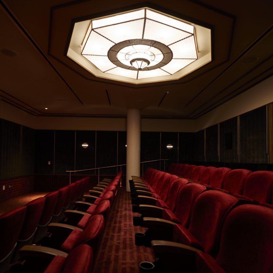 Movie theatre with iconic red velvet seats