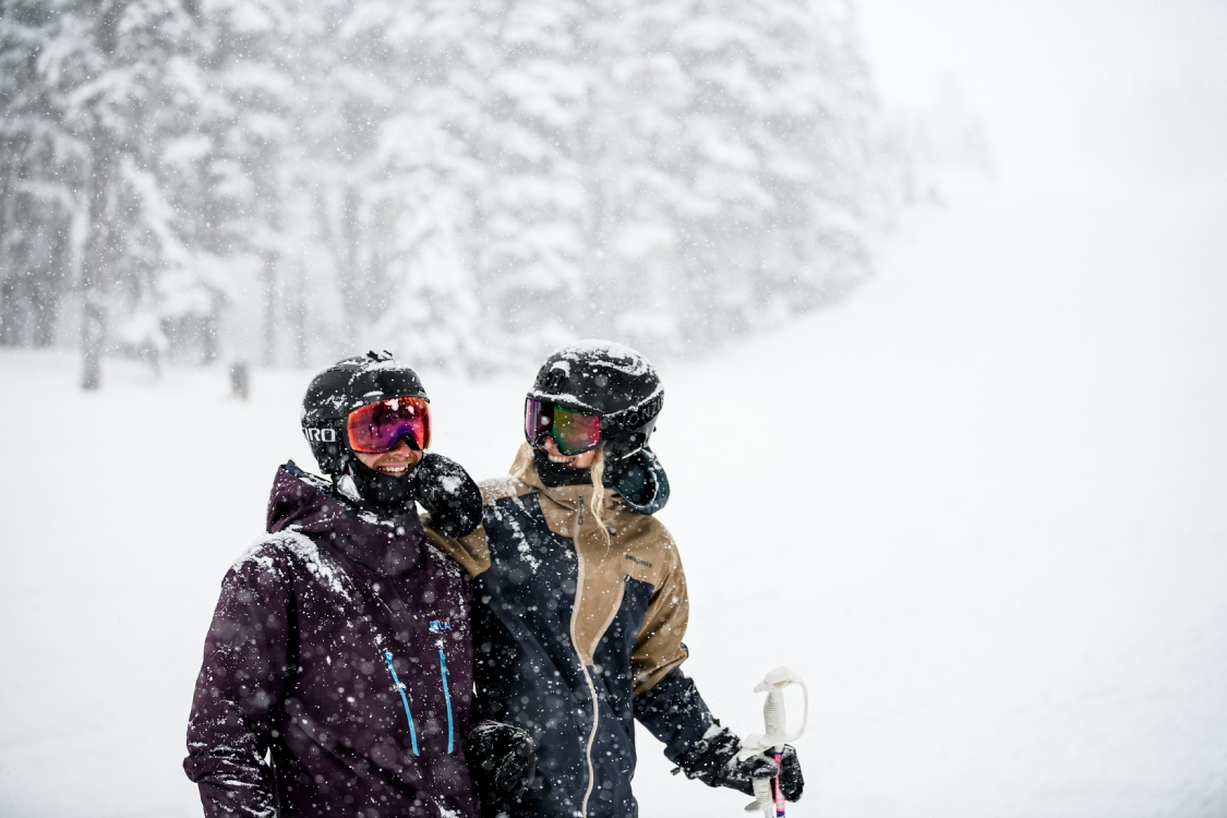 A couple enjoying the falling snow on Blackcomb Mountain