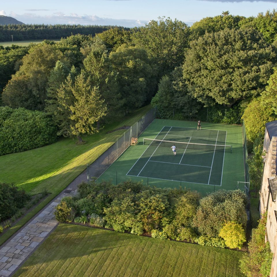Guests playing tennis at Glenapp Castle