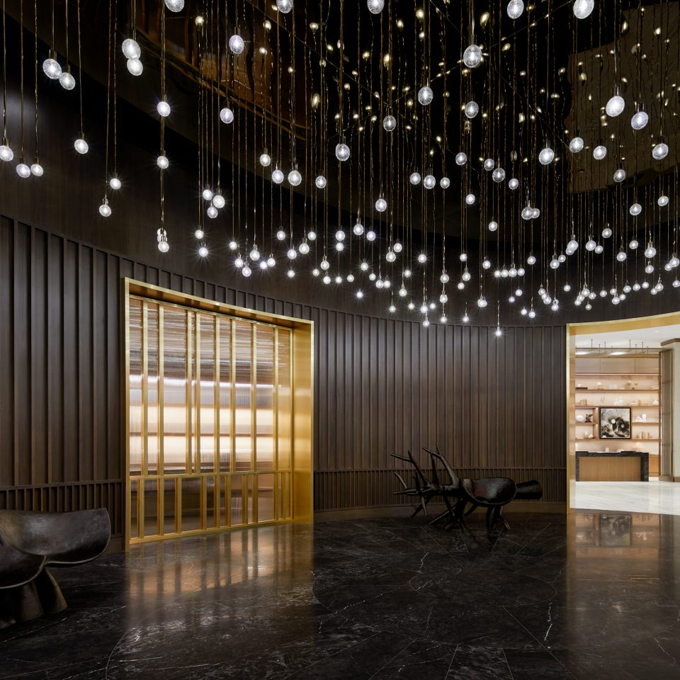 Dark themed lobby with light fixtures to look like stars overhead