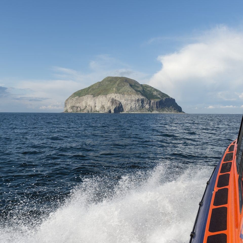 Glenapp boat taking tourists to large rock island