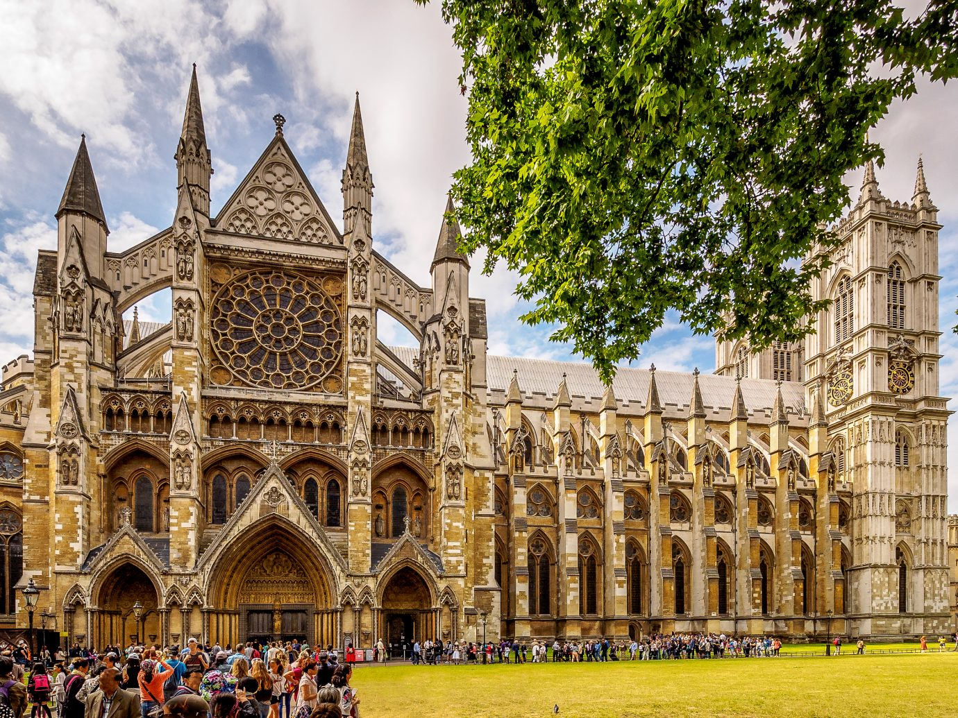 Multi-shop panorama of Westminster Abbey, London in high season;