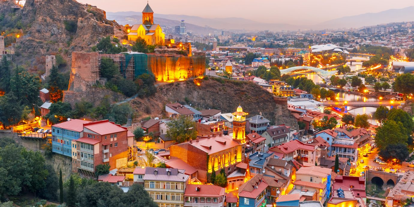 Narikala, Jumah Mosque, Sulphur Baths and famous colorful balconies in old historic district Abanotubani in night Illumination at sunset, Tbilisi, Georgia.