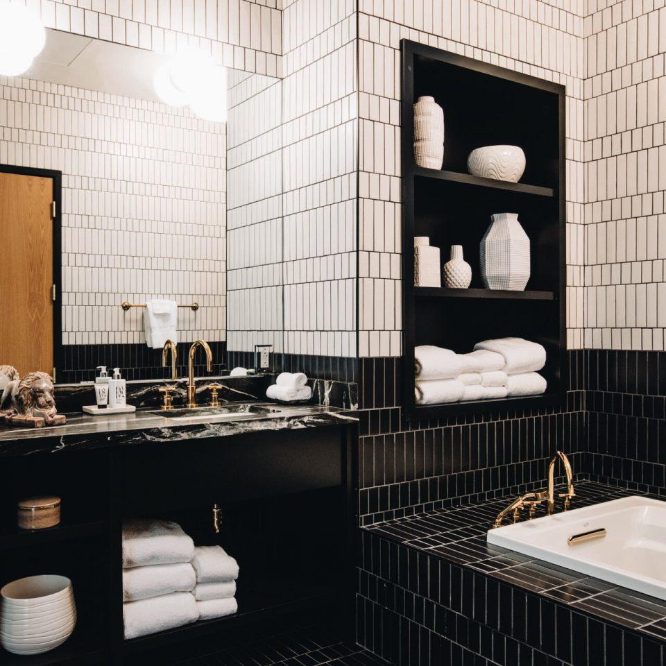 Black on bottom, white on top tiled bathroom