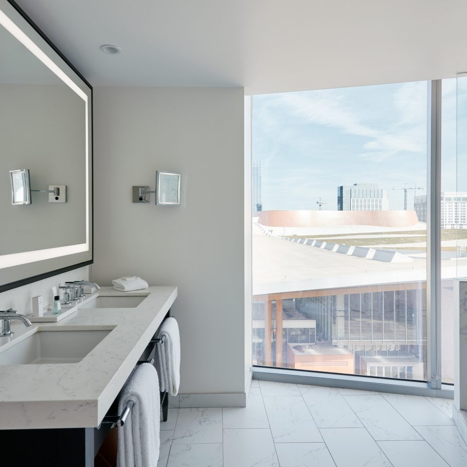 Double sink white bathroom with large wall window